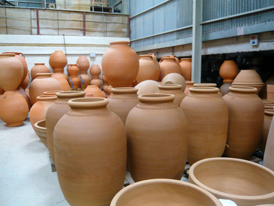 newly-fired-and-raw-tinajas.jpg