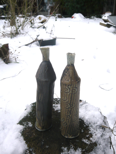 2-porcelain-bottles-in-the-snow2.jpg